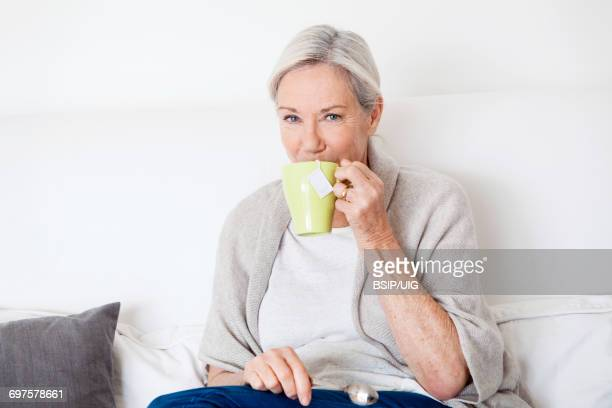 Elderly person with hot drink