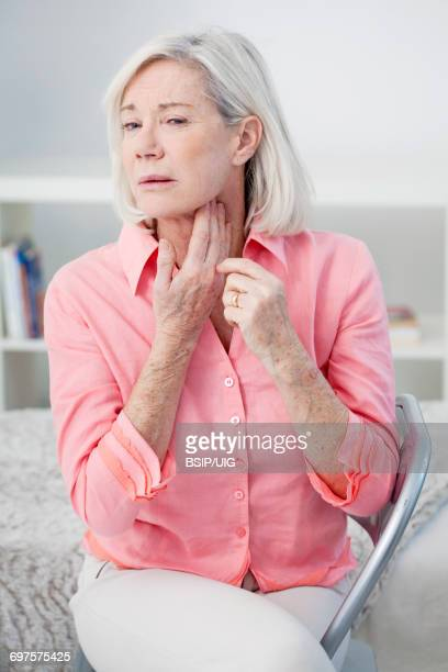 Elderly person with sore throat