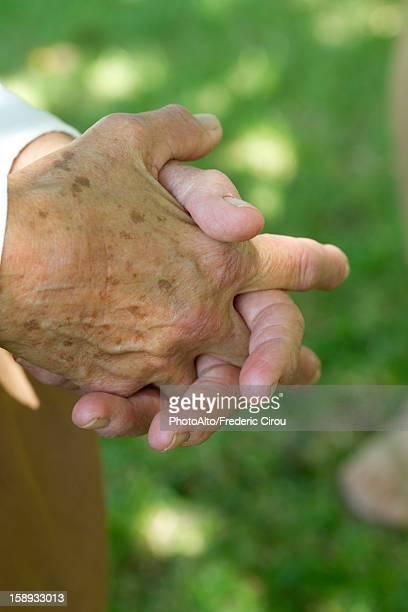 elderly person's clasped hands - lentigo fotografías e imágenes de stock
