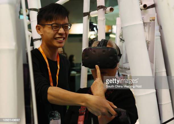 A elderly playing VR game at DesignInspire 2017 at Hong Kong Convention and Exhibition Centre in Wan Chai 07DEC17 SCMP / Nora Tam