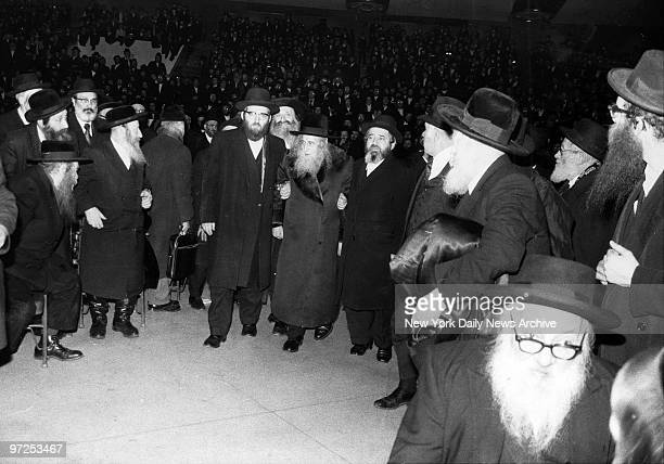 Elderly rabbi is assisted to podium at the Felt Forum of Madison Square Garden Thousand of Orthodox jews jammed the auditorium to hear speakers...