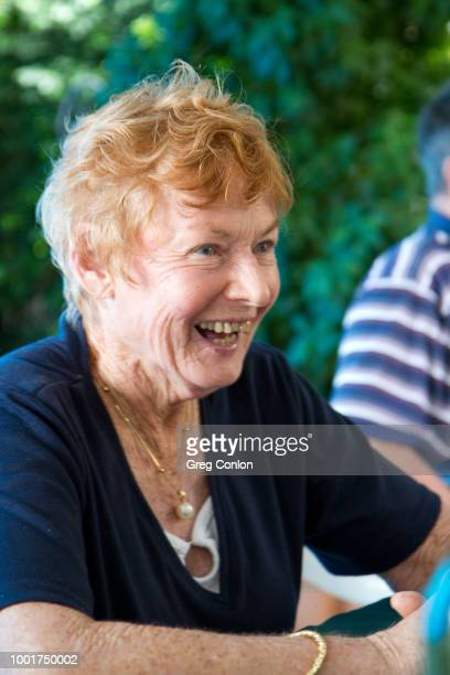 elderly redhead female laughing - gold tooth stock photos and pictures