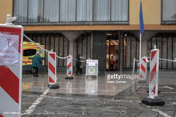 Elderly residents above 80 years old, who registered and are eligible for vaccination approach the vaccination centre on February 11, 2021 in Kranj,...