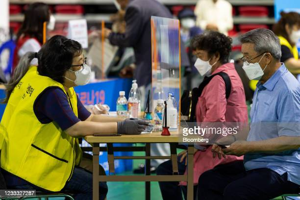 Elderly residents register to receive a dose of the Pfizer-BioNTech Covid-19 vaccine at a vaccination site inside the Incheon Samsan World Gymnasium...