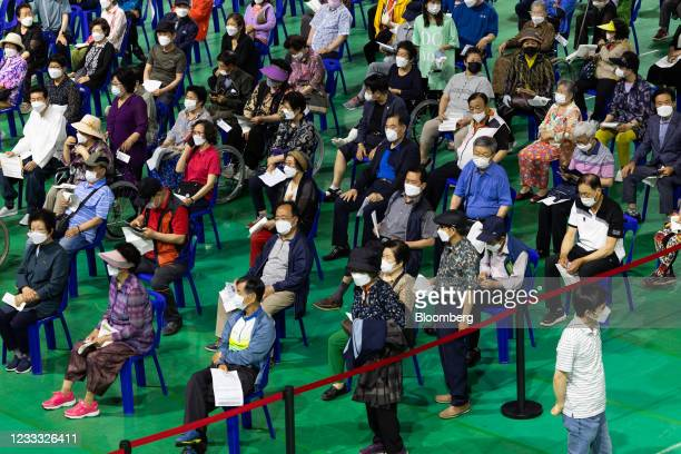 Elderly residents wait to receive a dose of the Pfizer-BioNTech Covid-19 vaccine at a vaccination site inside the Incheon Samsan World Gymnasium in...