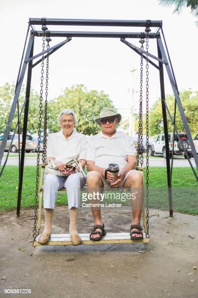 Elderly Retirees in good shape on park swing