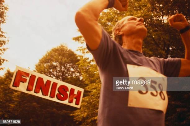 Elderly Runner Crossing Finish Line