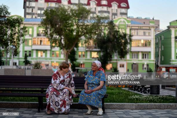 Elderly Russian women have a chat on a street in Samara on June 30 2018 during the Russia 2018 World Cup football tournament