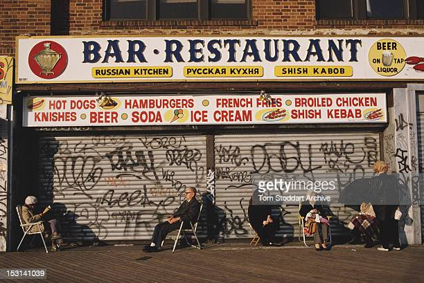 Elderly Russians sitting on deckchairs outside a Russian restaurant in 'Little Russia' Brighton Beach Brooklyn New York City 1989