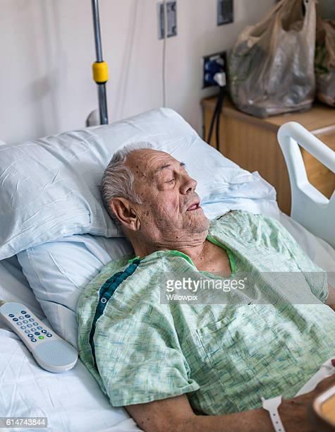 Elderly Senior Adult Man Medical Patient Resting in Hospital Bed