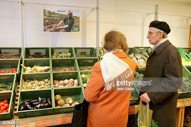 Elderly shoppers buy vegetables at a store of German organic supermarket chain EO Komma March 2 2005 in Berlin Germany According to the Londonbased...