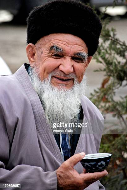 Elderly sipping green tea at Bukhara, the traditional drink of the Uzbeks. In Uzbekistan can be found everywhere the hai-khanas, tea houses. Bukhara,...
