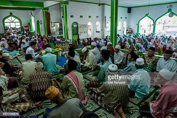 Elderly students gather to listen to an Islamic cleric's sermon at a boarding school Sepuh Payaman that cares for the elderly during Ramadan on July...