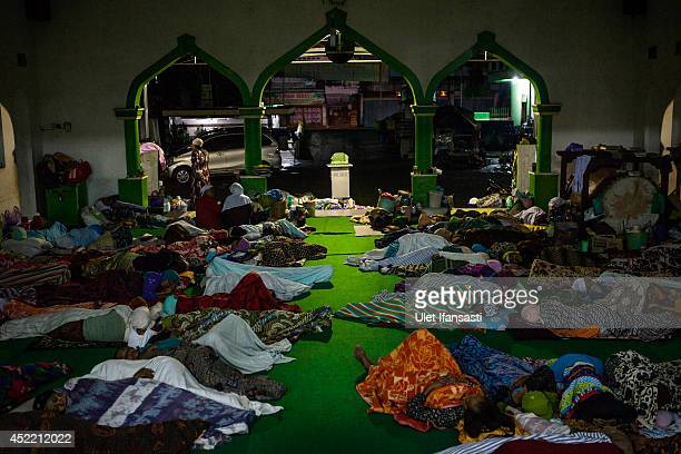 Elderly students sleep on the floor at a boarding school Sepuh Payaman that cares for the elderly during Ramadan on July 15 2014 in Magelang Central...