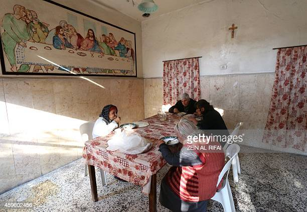 Elderly Syrian Christians share a meal at the Saint Elias centre for the elderly in the rebelheld side of the northern city of Aleppo northern city...