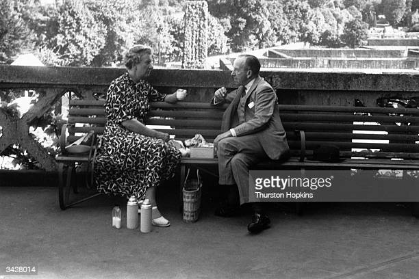 Elderly tennis fans enjoy a cup of tea at Wimbledon Original Publication Picture Post 6909 Wimbledon 1953 unpub