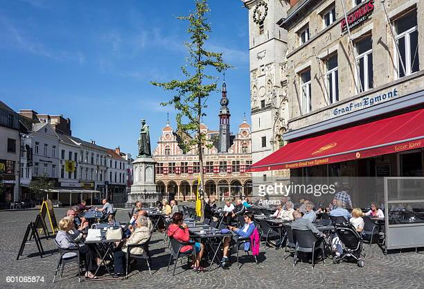 Elderly tourists at outdoor cafe on the town square in Aalst / Alost East Flanders Belgium