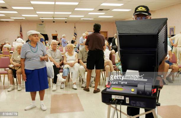 Elderly voters wait to cast their ballots on the new touchscreen electronic voting machines in the Century Village retirement community in Palm Beach...