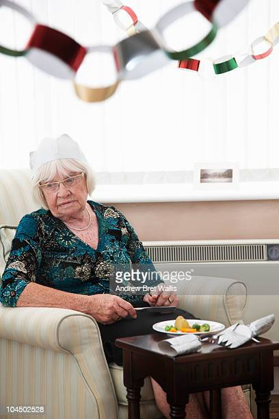 elderly woman alone & miserable at Christmas