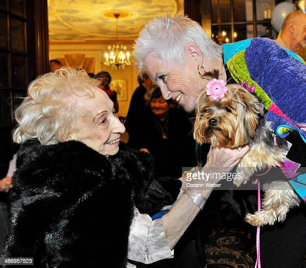 Elderly woman celebrates her 100th and greets her friend and dog