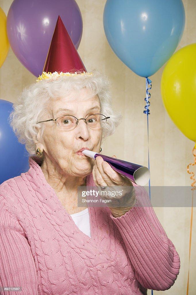Elderly Woman Celebrating Birthday Party : Stock Photo