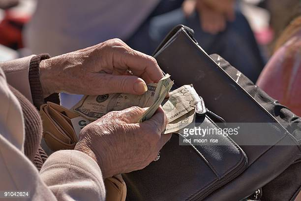 elderly woman counting money - social security stock pictures, royalty-free photos & images
