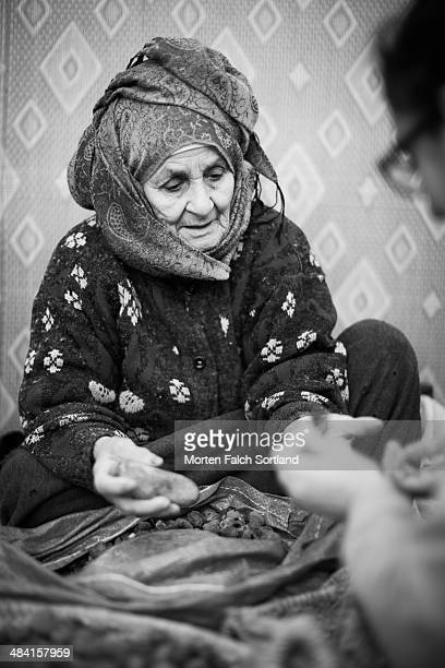 Elderly woman employed with producing argan oil at the Moroccan countryside at a cooperative