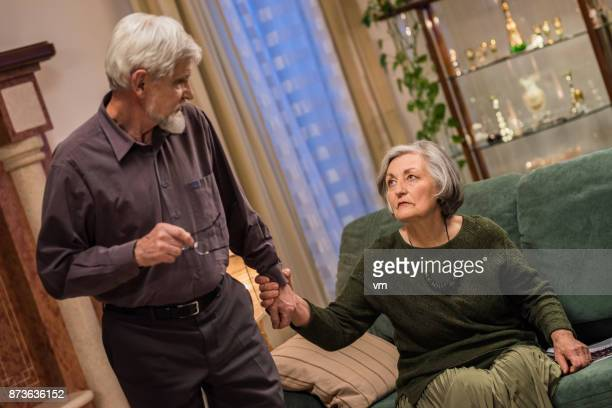 Elderly woman grabbing husband by the hand