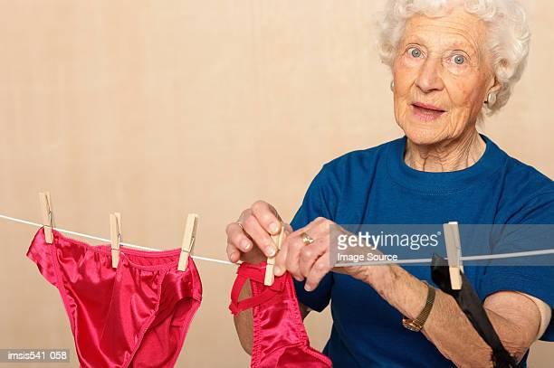 Elderly woman hanging out sexy underwear