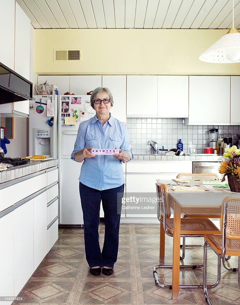 Elderly Woman Holding Weekly Pills : Stock Photo