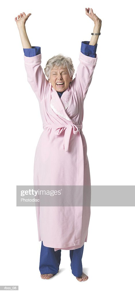 Elderly woman in a bathrobe stretches. : Foto de stock