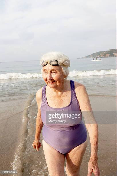 elderly woman in bathing suit on beach with goggle - one piece swimsuit stock pictures, royalty-free photos & images