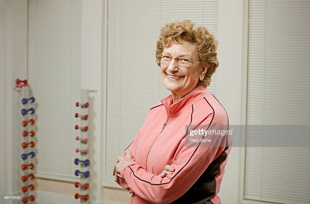 Elderly woman in gym at nursing home stock photo getty images