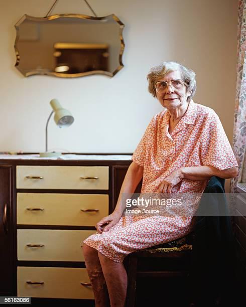 Elderly woman in her room