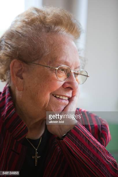 elderly woman is contemplative