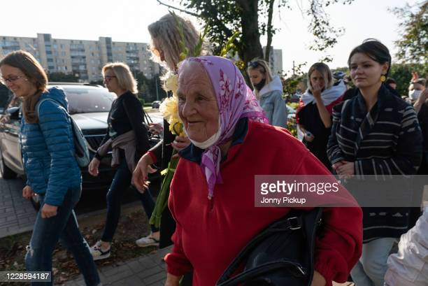 Elderly woman joins thousands of women marching in protest against the continued rule of president Alexander Lukashenko on September 19, 2020 in...