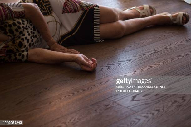elderly woman lying on floor after fall - ノックアウト ストックフォトと画像