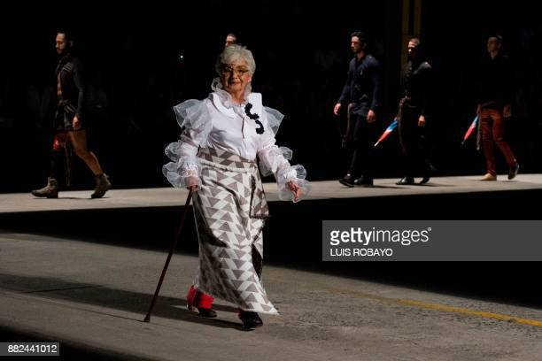 A elderly woman models a creation by Colombian designer Guio Di Colombia during the Walkway Inclusion fashion show in Cali Colombia on November 29...