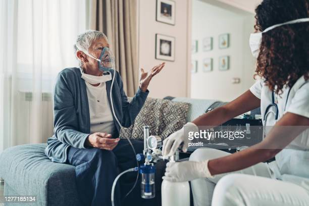 elderly woman needing breading device - oxygen mask stock pictures, royalty-free photos & images