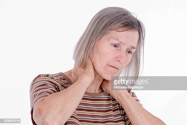 elderly woman, older than 65 years, suffering from neck hardening - 65 69 years stock pictures, royalty-free photos & images