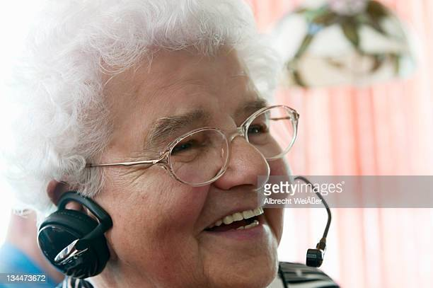 elderly woman on the phone, very pleased while using a headset for the first time, germany, europe - techniker stock pictures, royalty-free photos & images