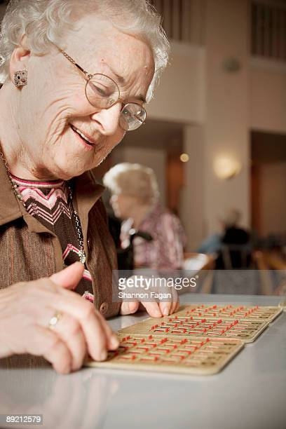 Elderly Woman Playing Games in Retirement Home