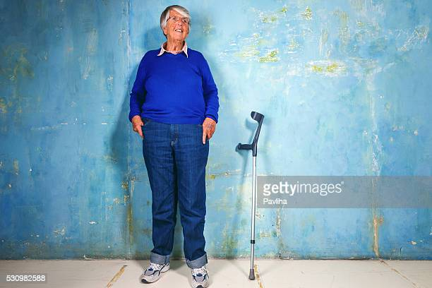 Elderly woman portrait with crutches ,Paris,France