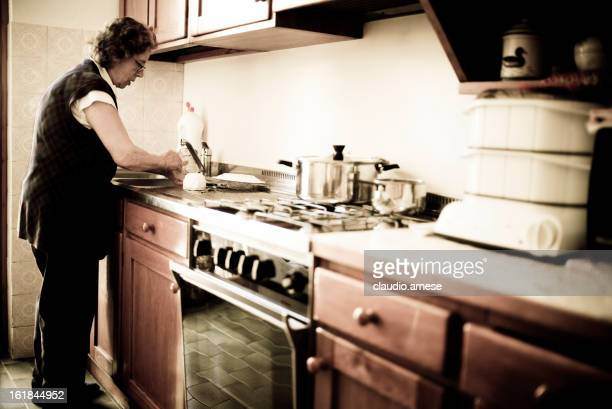 Elderly Woman Prepares Lunch. Toned Image