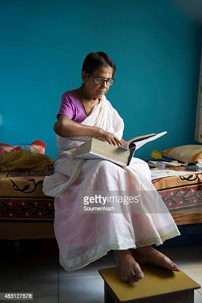 Elderly Woman reading a religious book