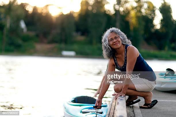 Elderly woman ready to kayak