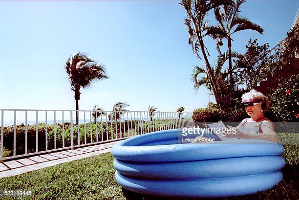 Elderly Woman Relaxing in Inflatable Pool