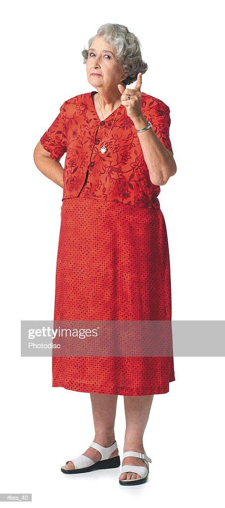 Elderly woman scowling and shaking her finger. : Foto de stock