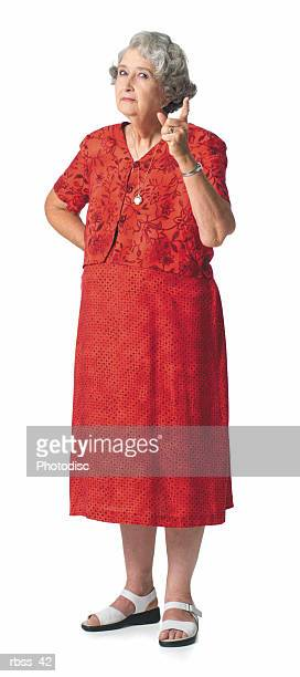 elderly woman scowling and shaking her finger. - cut out dress stock pictures, royalty-free photos & images