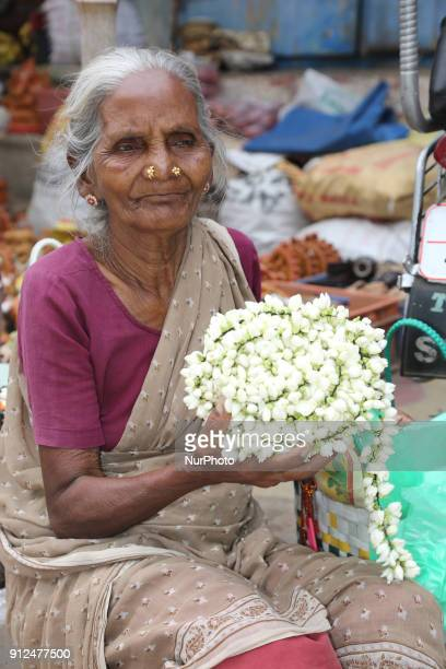 Elderly woman selling flowers outside the Nataraja Temple complex in Chidambaram Tamil Nadu India The Chidambaram Nataraja temple or Thillai Nataraja...